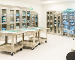 Wide view of a storage room with clean and sterile medical instruments and clothing in a hospital
